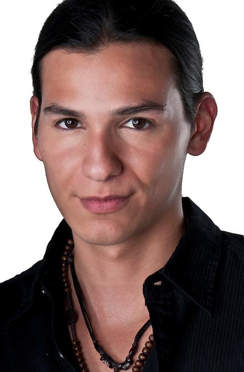 Portrait of youg hispanic male isolated.