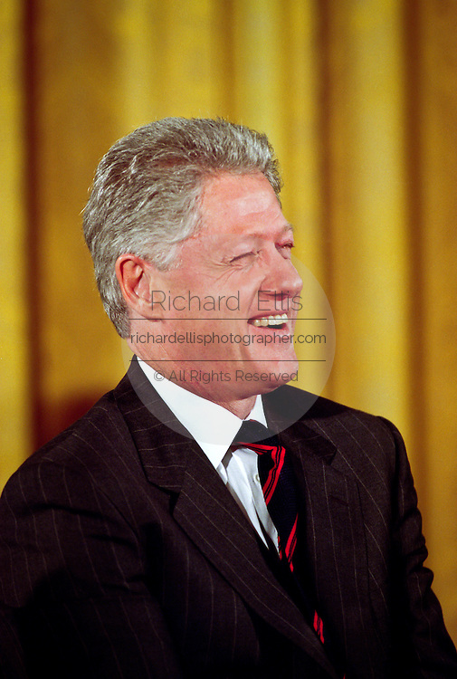 President Bill Clinton pauses during an event in the East Room of the White House January 13, 1999 where he made an announcement on support for the disabled.