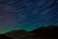 Night Sky, Star Trails, and Northern Lights looking northeast from Haines, Alaska. Composite of images from 01:00 to 01:29 taken with a Nikon D3x camera and 45 mm f/2.8 PC-E lens (ISO 400, 45 mm, f/5.6, 29 sec). Raw images processed with Capture One Pro and the composite generated using Photoshop CC (statistics, maximum).