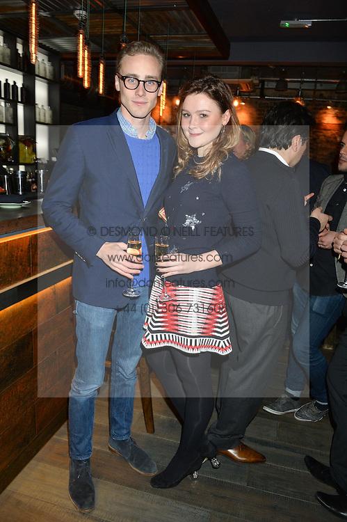 ALEX COLERIDGE and AMBER ATHERTON at the launch of Korean restaurant Jinjuu with chef Judy Joo at 15 Kingley Street, London on 22nd January 2015.