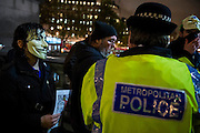 A crowd control message is displayed on the National Gallery  and leaflets are handed out by the police at the start - The annual Million Mask March bonfire night protest started in Trafalgar Square and headed to Westminster where it splintered. The march was organised by Anonymous UK and marchers wore the trademark V for Vendetta, Guy Fawkes masks. The police had placed tight restrictions on the route after trouble last year but, after a brief kettle, seemed happy to let the crowd filter in different directions.