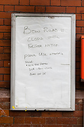 © Licensed to London News Pictures. 19/03/2020. London, UK. A 'Station Closed' sign on Bow Road tube station in London which closed this morning. Transport for London (TfL) are closing a number of underground stations from today, as partial closure of the tube and rail network begins in response to the growing coronavirus outbreak in the captial. Photo credit: Vickie Flores/LNP