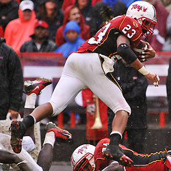 Sep 26, 2009; College Park, MD, USA; Maryland running back Da'Rel Scott (23) leaps over fallen players during the second half of Rutgers' 34-13 victory over Maryland in NCAA college football at Byrd Stadium.