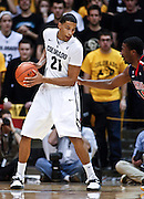 SHOT 1/21/12 5:25:06 PM - Colorado's Andre Roberson #21 looks to make a move on an Arizona player during their PAC 12 regular season men's basketball game at the Coors Events Center in Boulder, Co. Colorado won the game 64-63..(Photo by Marc Piscotty / © 2012)