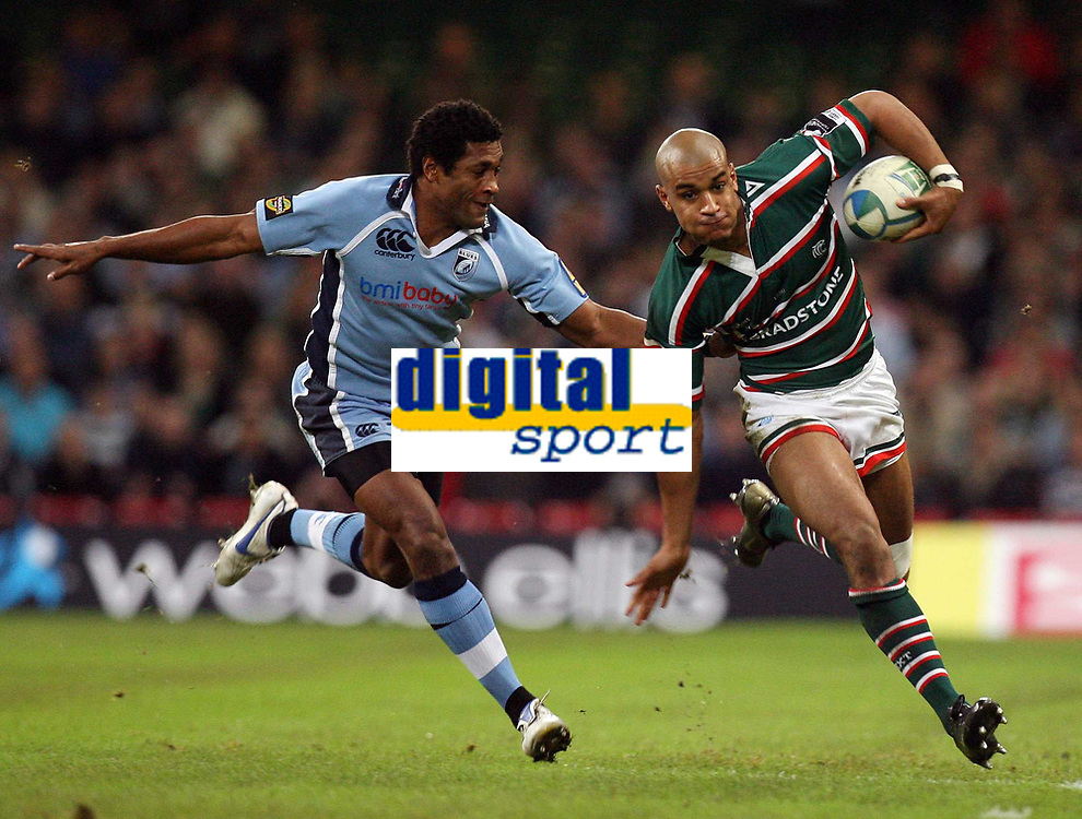 Photo: Rich Eaton.<br /> <br /> Cardiff Blues v Leicester Tigers. Heineken Cup. 29/10/2006. Mosese Luveitasau of Cardiff Blues  left tries to stop Tom Varndell of Leicester