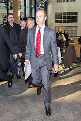 © Licensed to London News Pictures. 17/02/2018. Birmingham UK. Henry Bolton (grey suit red tie) arrives in Birmingham today as Ukip is holding an EGM today at the International Convention Centre in Birmingham to decide weather the party members will either back Henry Bolton as the party leader or endorse the No Confidence vote of the National Executive Committee.  Photo credit: Andrew McCaren/LNP