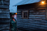 FARDC soldier Janine Bisimwa stands near her home in the Katindo barracks in Goma, D.R. Congo. She injured her eye a year ago in a motorcycle accident while her unit was returning to Goma after M23 had released control of the city.