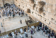 The area in front of the Western Wall is a great, open-air, haredi synagogue. To attend modest dress is recommended and a kippah is required for men. Open 24 hours, 365 days a year, it's divided into a small southern section for women and a more active, larger northern section for men.<br /> Until 2013, non-Orthodox prayer was not allowed at the Wall due to the regulations of the Law of the Holy Places, and thus women who prayed using tallits and tefillin were often arrested and given restraining orders keeping them away. Thanks to the decade long struggle of the organization Women of the Wall, in April 2013, Judge Moshe Sobel of the Jerusalem District Court ruled that as long as there is no other appropriate area for pluralistic prayer, women should be allowed to pray according to non-Orthodox customs at the Wall.<br /> Haredi Orthodox rabbi of the Western Wall, Rabinowitz, refuses to abide any deviation from traditional Jewish law, which prohibits women from singing aloud, reading the Torah and wearing a tallit at the Kotel. Violations are punishable by up to six months in prison or a fine of about $125.