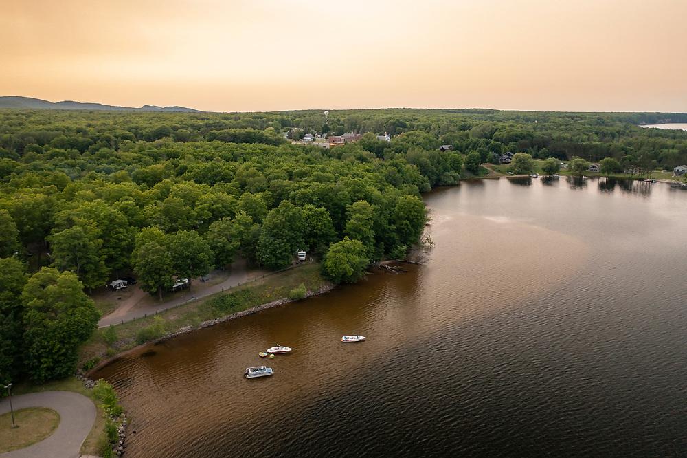 Boats on Lake Independence at dusk in Big Bay, Michigan.