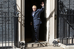 London, UK. 24 July, 2019. Boris Johnson waves as he enters 10 Downing Street for the first time as Prime Minister after having been formally appointed by the Queen at Buckingham Palace.