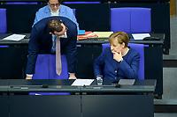 08 DEC 2020, BERLIN/GERMANY:<br /> Jens Spahn (L), CDU, Bundesgesundheitsminister, mit Maske, und Angela Merkel (R), CDU, Bundeskanzlerin, im Gespraech, Haushaltsdebatte, Plenum, Reichstagsgebaeude, Deuscher Bundestag<br /> IMAGE: 20201208-02-027<br /> KEYWORDS: Mund-Nase-Schutz, Corona, Corvid-19, Gespräch, Mundschutz