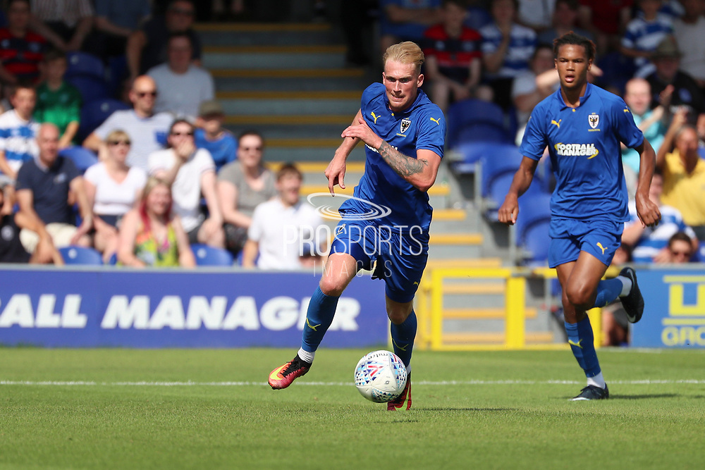 Wimbledon midfielder Mitchell (Mitch) Pinnock (11) dribbling during the Pre-Season Friendly match between AFC Wimbledon and Queens Park Rangers at the Cherry Red Records Stadium, Kingston, England on 14 July 2018. Picture by Matthew Redman.