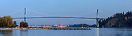 Panorama of the Lions Gate Bridge, the Port of Vancouver, and Ambleside Beach.  Photographed in the evening from Ambleside Fishing Pier betwen John Lawson and Ambleside Parks along the shoreline in West Vancouver, British Columbia, Canada.