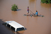 """NANNING, CHINA - SEPTEMBER 21: (CHINA OUT) <br /> <br /> Flood Peak Arrives At Nanning<br /> <br /> Two citizens boat for fish near Lingtie Bridge on September 21, 2014 in Nanning, Guangxi province of China. The highest water level at Yongjiang River in a year comes as Typhoon """"Kalmaegi"""" hit Nanning on September 20. The flood peak runs up to 74.83 meters and has been a biggest flood peak since 2008. (<br /> ©Exclusivepix"""