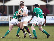 29 Feb 2010 Esher, Surrey: England's Emily Scarratt is tackled by Fiona Coughlin (L) and Marie Louise Reilly (R) during the Women's Six Nations game between England and Ireland at Esher Rugby Club (photo by Andrew Tobin/SLIK images)