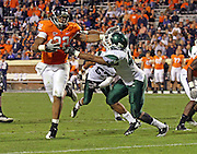 Oct 23, 2010; Charlottesville, VA, USA;  Virginia Cavaliers running back Keith Payne (22) runs in front of Eastern Michigan Eagles linebacker Marcus English (42) during the game at Scott Stadium.  Virginia won 48-21. Mandatory Credit: Andrew Shurtleff