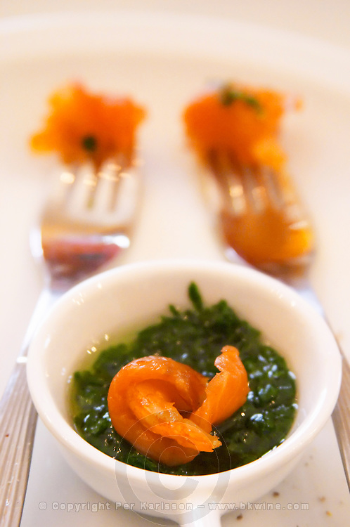 smoked Patagonian salmon and parsley in olive oil and herbs on two forks and in a cup Bodega Del Anelo Winery, also called Finca Roja, Anelo Region, Neuquen, Patagonia, Argentina, South America
