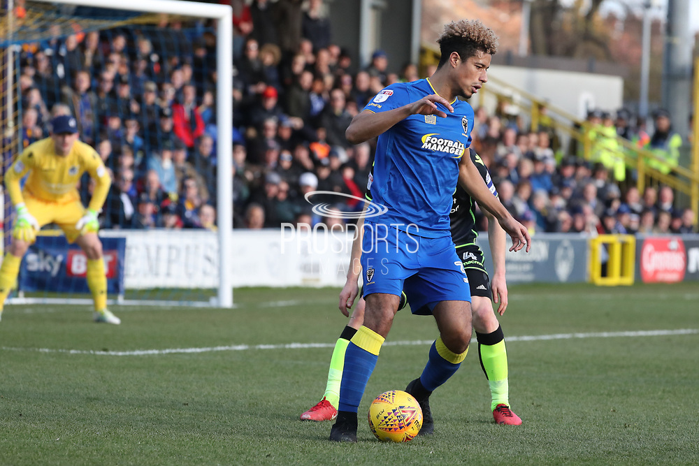 AFC Wimbledon striker Lyle Taylor (33) holding up the ball during the EFL Sky Bet League 1 match between AFC Wimbledon and Bristol Rovers at the Cherry Red Records Stadium, Kingston, England on 17 February 2018. Picture by Matthew Redman.