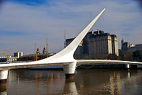 "Bridge ""La Mujer"" in Puerto Madero, Buenos Aires. The Bridge was designed by Santiago Calatrava and its a Landmark on this tourist destination in Buenos Aires."