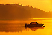 boat on Raven Lake at dawn; sunrise; recreation; cottage country<br />Dorset<br />Ontario<br />Canada