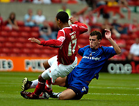 Photo: Ed Godden.<br />Nottingham Forest v Bradford City. Coca Cola League 1.<br />05/08/2006. James Perch (L) is tackled by Bradford's Steven Schumacher.
