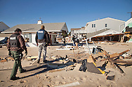 Ortley Beach, New Jersay, November 3, 2012,  Police walk through a destroyed neighborhood after Hurricane Sandy's surge flooded the entire barrier island. The Jersey shore took the brunt of Hurricane Sandy.