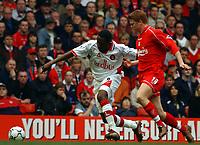Fotball. Engelsk Premier League 30.03.2002.<br /> Liverpool v Charlton.<br /> Jason Euell, Charlton.<br /> John Arne Riise, Liverpool.<br /> Foto: Roger Parker, Digitalsport