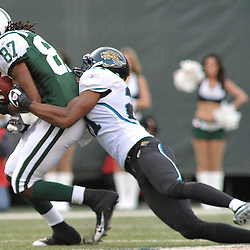 Nov 15, 2009; East Rutherford, NJ, USA; New York Jets wide receiver David Clowney (87) makes a catch while being dragged down by Jacksonville Jaguars cornerback Derek Cox (21) during second half NFL action in the Jacksonville Jaguars 24-22 victory over the New York Jets at Giants Stadium.