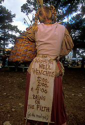 Stock photo of a woman wearing an advertisement for her show at the Texas Renaissance Festival in Plantersville Texas