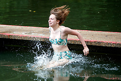 © Licensed to London News Pictures. 25/05/2017. London, UK. People swim in Hampstead Heath Mixed Bathing Pond in north London as temperatures hit 29C on Thursday 25 May 2017. Photo credit: Tolga Akmen/LNP