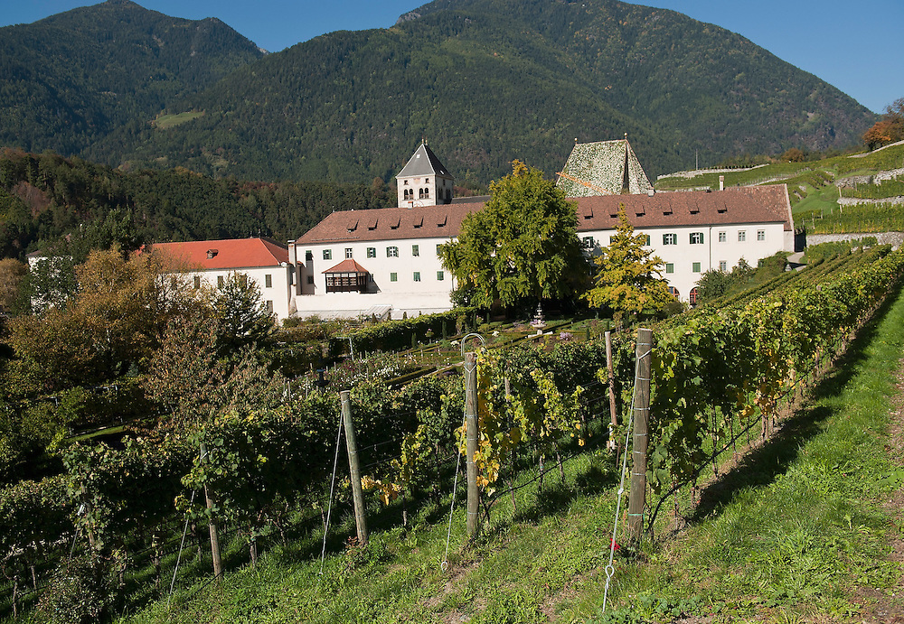 VARNA, ITALY - OCTOBER 13: A panoramic view of  Abbazia di Novacella and its vineyards on October 13, 2010 in Varna, Italy. Abbazia di Novacella, in Alto Adige established in the year 1142 by Augustinian monks, is one of the oldest vineries in the world; it has a production of about 400,000 bottles of world class wines including Kerner, Sylvaner, Pinot Grigio, Gewurtztraminer.