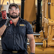 Worker at Caterpillar dealer