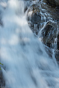 Water smoothly flows over rocks on its way down Madcap Falls.