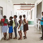 INDIVIDUAL(S) PHOTOGRAPHED: N/A. LOCATION: Sacré-Cœur Hospital, Milot Commune, Cap-Haïtien, Haïti. CAPTION: Patients wait to receive their medication at the pharmacy window at Sacré-Cœur Hospital.