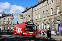 A bus of Scottish Labour arrives to the Bute House in Charlotte Square in Edinburgh.<br /> Scottish Labour deputy leader Anas Sarwar and credit union leader worker Alison Dowling deliver a giant pound coin to Bute House. The First Minister's official residence, to highlight uncertainty over what currency an independent Scotland would use.<br /> <br /> Pako Mera/Universal News And Sport (Europe) 07/08/2014
