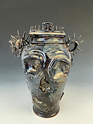 Death Urn, Jan 1 4 2021, 15x10x9<br /> <br /> Artist Bio<br /> William Lescheck is currently working and selling his work at Belltower coffeehouse and<br /> ceramic studio. There he creates his work alongside Belltower's own wholesale orders to<br /> businesses around Memphis. Along with creating, he also teaches classes for new people to<br /> experience the creative joy of ceramics.<br /> Mr. Lescheck was a Ceramic and Sculpture alumni from the University of Memphis in<br /> Memphis, TN. Being raised in the small town of Selmer Tennessee, he graduated from McNairy<br /> Central Highschool where he started to create art. He graduated from Jackson State Community<br /> College with an Associate Degree in Fine Arts, and went on to get his Bachelor's Degree at The<br /> University of Memphis. While he was obtaining his degree he participated in exhibitions and<br /> sales across Memphis, from Crosstown Sculptor Student Exhibition at Crosstown Concord to<br /> participating in The Memphis Potters' Guild Sale at Saint Anne Catholic Church.