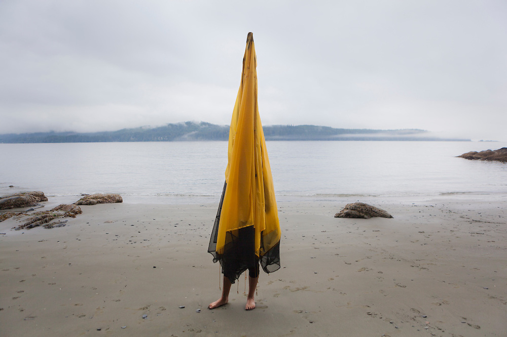 Henry stands inside a tent to dry it out at Thrasher Cove, West Coast Trail, British Columbia, Canada.