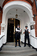 London, UK. Thursday 16th August 2012. Police on duty outside the Ecuador Embassy in London, as people await information on whether he will be granted political asylum, or be extradited from the UK.