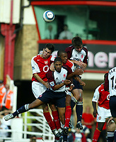 Fotball<br /> Premier League 2004/05<br /> Arsenal v Middlesbrough<br /> Highbury<br /> 22. august 2004<br /> Foto: Digitalsport<br /> NORWAY ONLY<br /> Arsenal players Fabregas and Gilberto and Boro players Reiiger and Riggott challenge