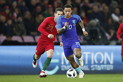 (L-R) Adrien Silva of Portugal, Memphis Depay of Holland during the International friendly match match between Portugal and The Netherlands at Stade de Genève on March 26, 2018 in Geneva, Switzerland