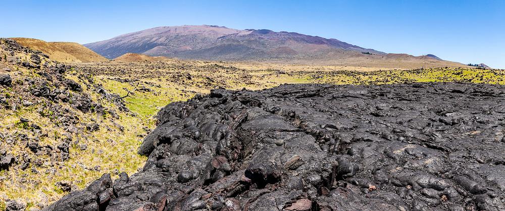 Mauna Kea and old lava flows off of Saddle Road Route 200 on Hawaii, The Big Island, USA.