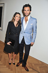 MARK-FRANCIS VANDELLI and KATY WICKREMESINGHE at a party to celebrate the launch of the new gallery Pace at 6 Burlington Gardens, London on 3rd October 2012.