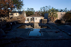 03 Oct, 2005.  New Orleans, Louisiana. Lakeview.  Hurricane Katrina aftermath. <br /> The remnants of the lives of ordinary folks, now covered in mud as the flood waters recede. A cross shaped pool now black with sludge.<br /> Photo; ©Charlie Varley/varleypix.com
