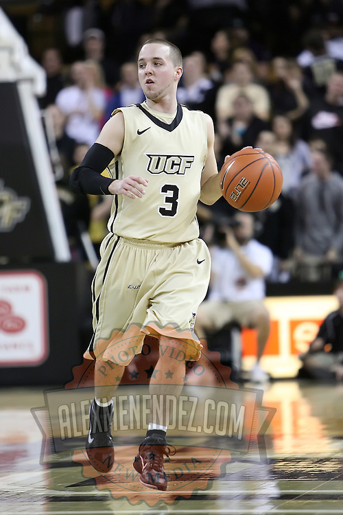 Central Florida guard A.J. Rompza (3) dribbles up court during a Conference USA NCAA basketball game between the Rice Owls and the Central Florida Knights at the UCF Arena on January 22, 2011 in Orlando, Florida. Rice won the game 57-50 and extended the Knights losing streak to 4 games.  (AP Photo/Alex Menendez)