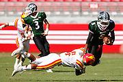 Oakdale defensive back Kevin Corral (5) sacks Manteca quarterback Dakarai Charles (8) during Friday Night Lights at Levi's Stadium in Santa Clara, California, on October 11, 2014. Oakdale beat Manteca 42-21. (Stan Olszewski/ Special to The Record)