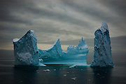"""Limited edition Giclée Prints available - contact me for more details.<br /> <br /> This iceberg reminds of the painting by Bocklin called """"The Isle of the Dead"""" - it's difficult to show scale with an image like this, but the iceberg was at least 100m tall in places, if not more. Photographed from on board the Greenpeace ship Esperanza, in the Southern Ocean, 8th February 2007. .... This mage can be licensed via Millennium Images. Contact me for more details, or email mail@milim.com For prints, contact me, or click """"add to cart"""" to some standard print options."""