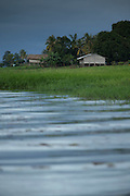 Lakeside wooden huts, Lake Murray, Middle Fly District, Western Province, Papua New Guinea