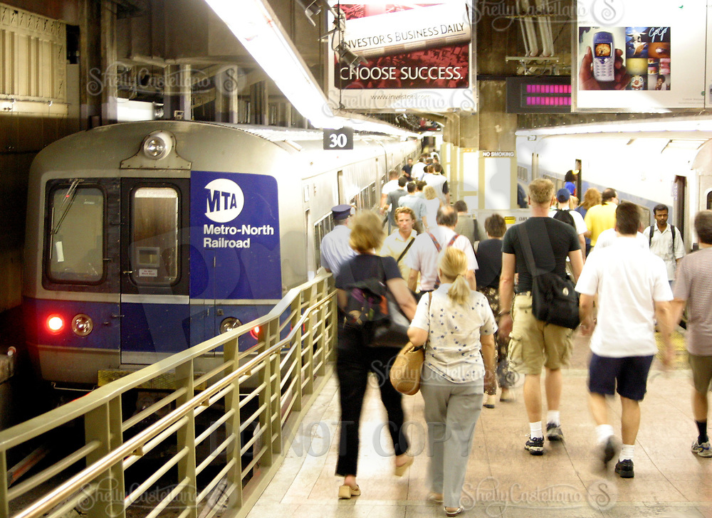 Aug 16, 2002; New York, NY, USA; Passengers loading onto Metro-North Railroad departing from track 30 from Grand Central Station.  Thousands of railroad and subway commuters use these cars every day.  Mandatory Credit: Photo by Shelly Castellano/ZUMA Press. (©) Copyright 2002 by Shelly Castellano