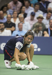 September 5, 2018 - Flushing Meadows, New York, U.S - Ball girl cleans the sweat on the court during the match between Novack Djokovic and John Millman on Day 10 of the 2018 US Open at USTA Billie Jean King National Tennis Center on Wednesday September 5, 2018 in the Flushing neighborhood of the Queens borough of New York City.  An invocation of the 'Equipment Out of Adjustment' rule was made due to excessive sweat by both players. Novack Djokovic defeats Millman, 6-3, 6-4, 6-4. (Credit Image: © Prensa Internacional via ZUMA Wire)