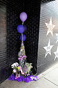Star, memorial bouquets and balloons honoring Prince's life and music. First Avenue Nightclub Minneapolis Minnesota MN USA